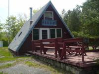 Our petite, barn red, 1,100 sq.ft. A-Frame is located