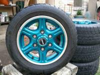I have a set of four Blue-Green Mazda Wheels for sell.