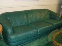 Dark green sofa - not leather. Good structural