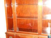 This is a wood china cabinet, looks duncan phyfe style.
