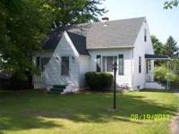 THIS 1957 CAPE COD ON APPROX 1/2 ACRE LOT IN MILLCREEK