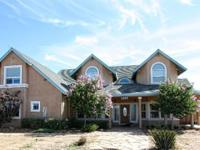 Fantastic custom home on 19.45 acres that overlooks a