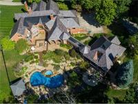Located on 10 private acres, this stately Sewickley
