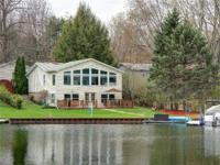 What a fantastic lakefront house! Numerous updates to