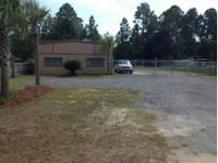 Commercial property for sale. Building is split 80/20
