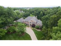 Stately custom built 1.5 story home situated on 2.34