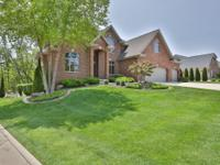 WARM AND RELAXING DESCRIBES THIS 1.5 STORY HOME EXUDING