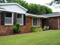 This newly repainted 4 bedroom, 3 bath brick cattle