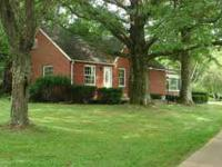 This 3 bedroom brick house is situated on 2 acres in