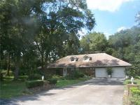 Custom 4/3.5 brick home on almost an acre wooded lot