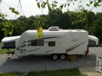 We have for sale a 24' hybrid camper with a slide out