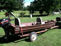 12 ft or approx. flat btm boat. 6 hp mercury motor.