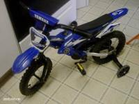 12 inch blue Yamaha motorbike bicycle. We bought this