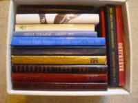 Hi there, offered is a box of 12 school yearbooks from