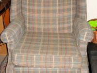 Upholstered wing back chair in good condition. No tears