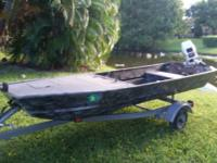 12ft Jon Boat with custom paint & carpeted front deck.