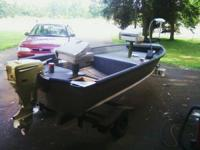 12ft Starcraft semi v rowboat with trailer. has