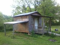 This is a 12 foot by 12 foot cabin with a front porch