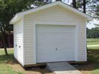 12X12 PORTABLE STORAGE BLDG. HAS A 8 FOOT GARAGE DOOR,