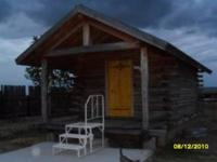 I am selling a custom built 12' x 18' log cabin w/ a