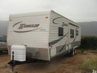 26 foot Wrangler by Ameri- Camp with a 15' awning 12'