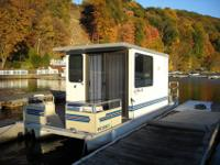 26 ft Lil Hobo Houseboat with Nissan 50 hp outboard and