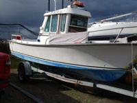 "1983 Shamrock Pilothouse7'11"" beam, 2'6"" draftV-8 Ford,"