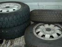 Nearly new studded tires off of a VW Rabbit. White