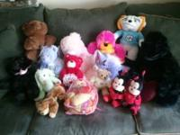 13 assorted stuffed animals and a doll for sale. All in