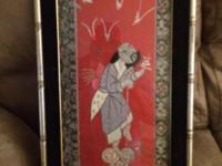 This an antique Chinese Wall art. It is made from an