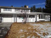 3000 sf tri-level home with basement on 1/2 acre lot