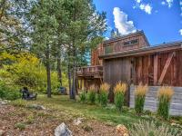 This mountain modern in Alpine Meadows sits on a sunny,