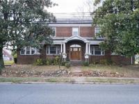 This spacious four-level all brick federal style home
