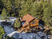 Serenity seekers, this is it! Secluded, custom mountain