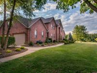 Stately 2 story home situated on a beautifully treed