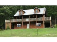 128 ACRES OF MOUNTAIN LAND AN LOG SIDED HOME. THIS