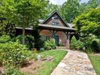 This family timber-frame home privately sits at the end