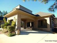 Stunning custom home on 2 lots overlooking Woodcreek