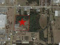25 Acres with 984ft of frontage on South Memorial