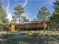 Lovely one story ranch log residence. Terrific space