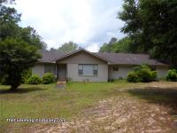 Welcome to 1331 Forest Ridge Rd E in Mobile. This split
