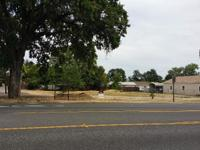 Great corner lot with 130 ft. frontage on Hwy 99. South