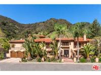 Sitting on a 1.5 acre lot sheltered by a mountainside,