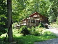 DESCRIPTION.  Poplar Nook-- Rustic cabin with plenty of