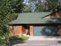 For sale by owner, Beautiful log sided twin home in