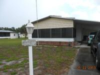 WELL MAINTAINED MANUFACTURED HOME IN RIVERFRONT