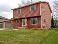 Spacious 3 Bedroom home with finished basement nestled