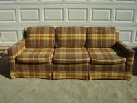 Heres a nice plaid couch thats color is in the tan
