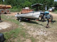 alum. v hull boat with tilt trailer. Boat is in good