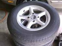 SET OF 14'' ALUMINUM 4 LUG RIMS WITH GOOD TIRES FOR